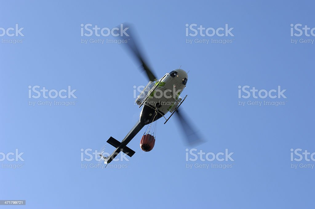 Helicopter Flying Above an Out of Control Wildfire stock photo