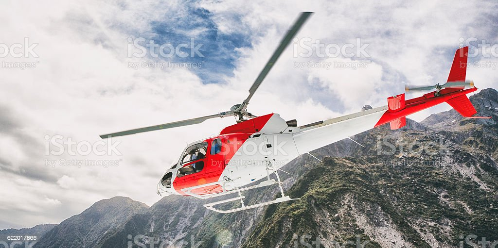 Helicopter flying above the Southern Alps, New Zealand stock photo