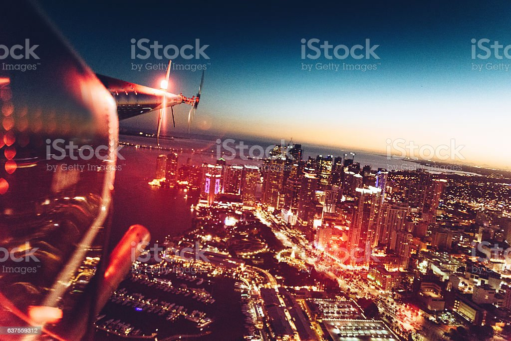 helicopter flying at dusk in miami stock photo