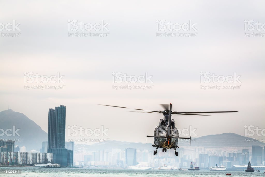 Helicopter flying, Hong Kong. stock photo