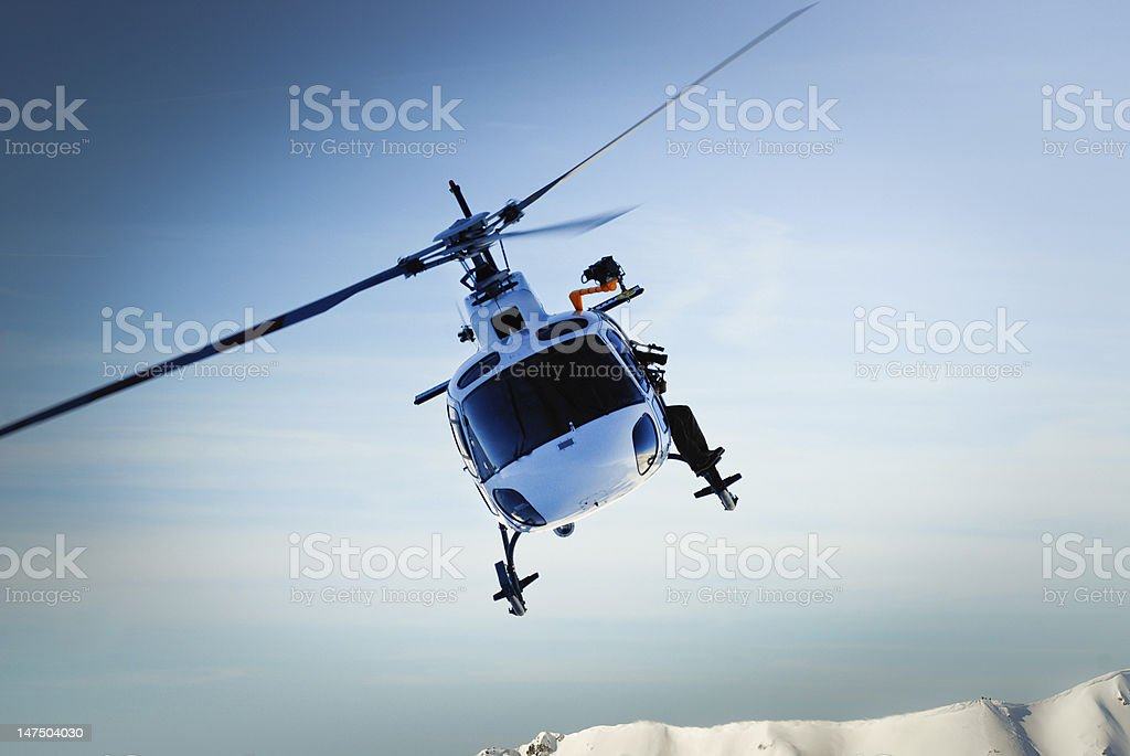 A helicopter flying in the air stock photo