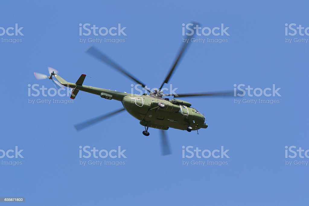 Helicopter flying in the sky in search of people stock photo