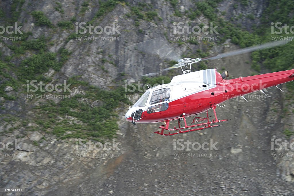 Helicopter Flying Near Mountain royalty-free stock photo