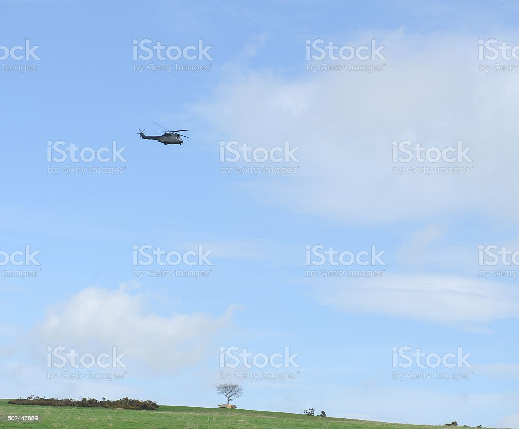 Helicopter Flying over Cleeve Common in the Cotswolds stock photo