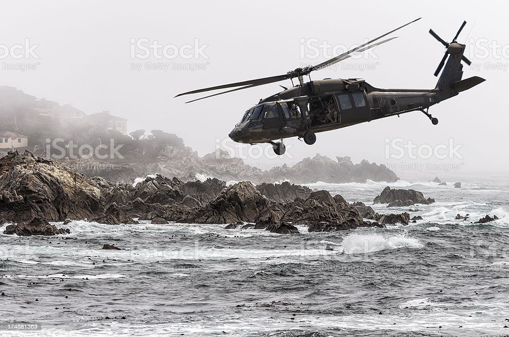 Helicopter Flying Over Coastline stock photo