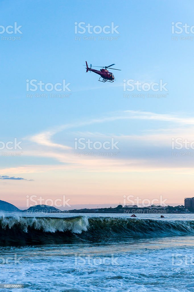 Helicopter flying over Copacabana Beach at sunset, Rio de Janeiro stock photo
