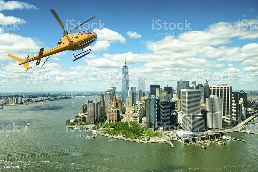 Helicopter flying over Freedom Tower, Financial District, NYC. Aerial View. royalty-free stock photo