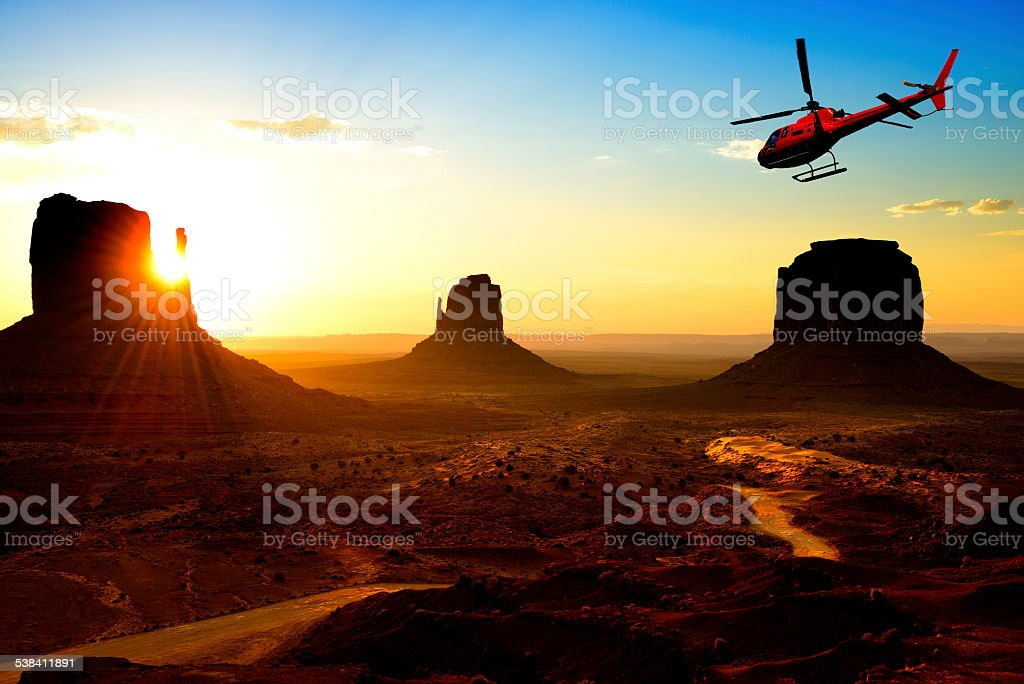 Helicopter Flying over Monument Valley stock photo