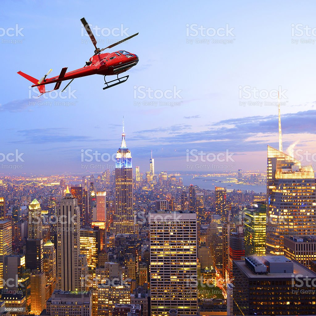 Helicopter flying over NYC and Empire State Building. Aerial View stock photo