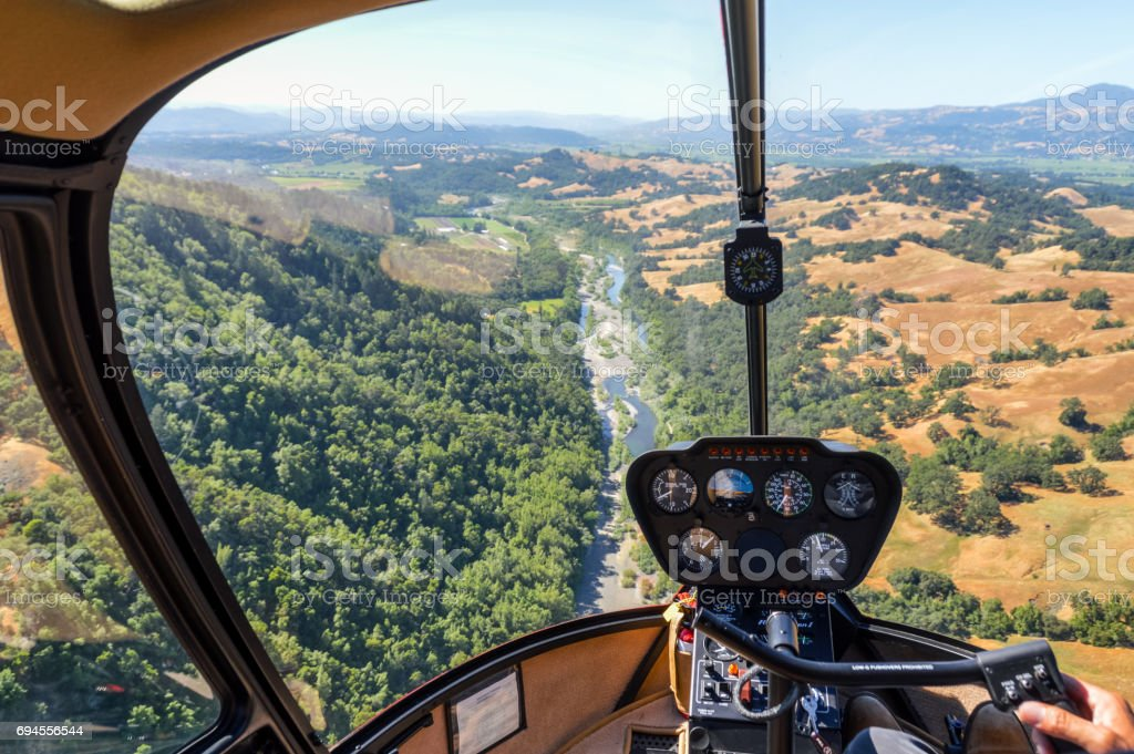 Helicopter flying over river in Napa Valley, California stock photo