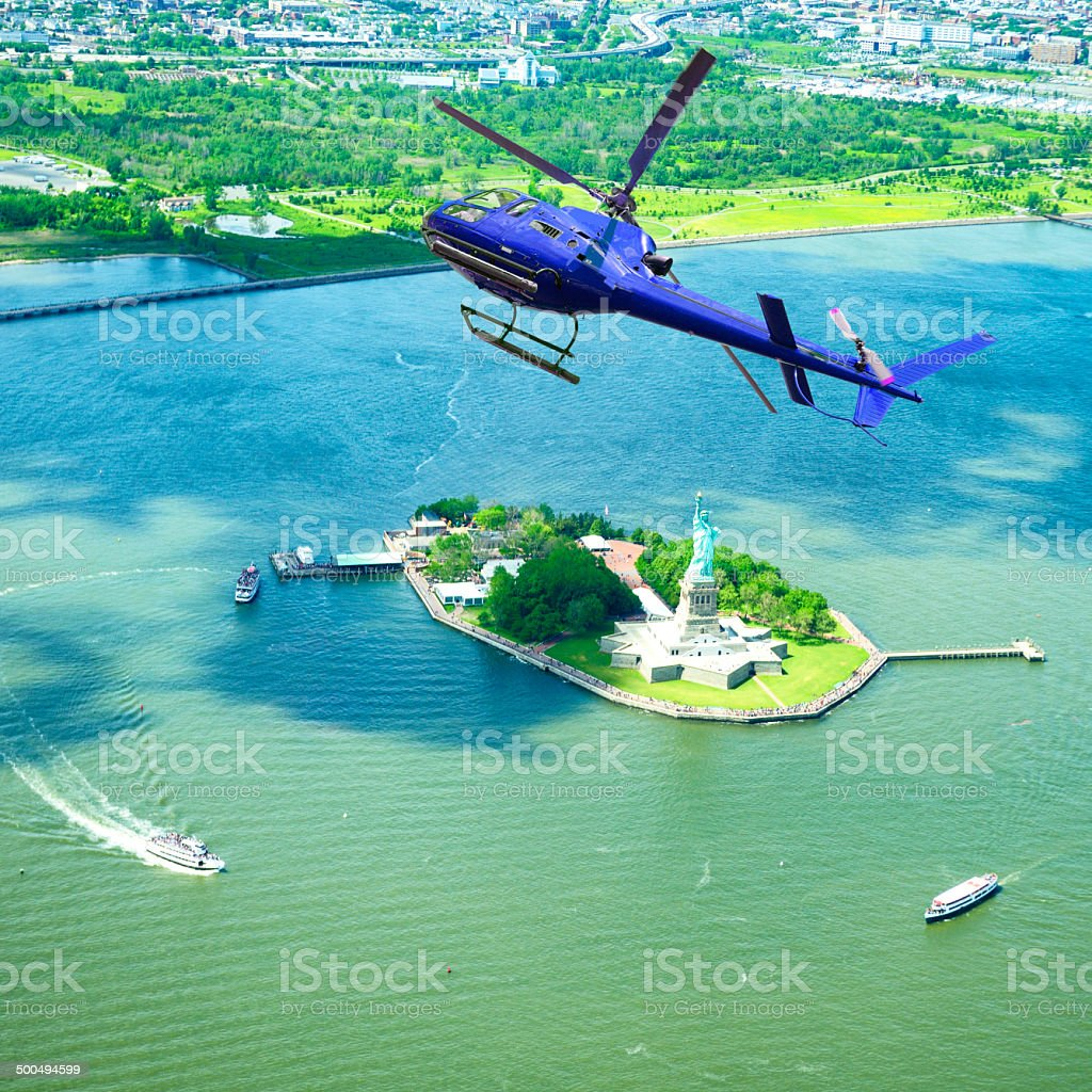 Helicopter Flying over Statue of Liberty, NYC. royalty-free stock photo