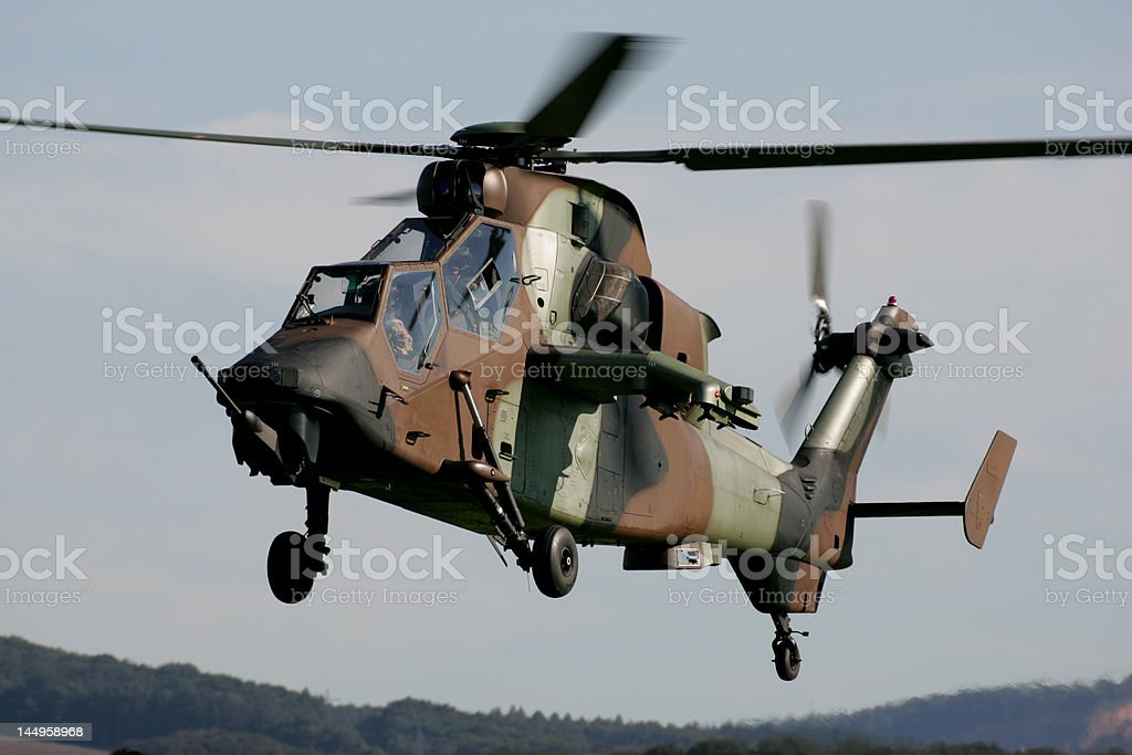Helicopter gunship hovering royalty-free stock photo