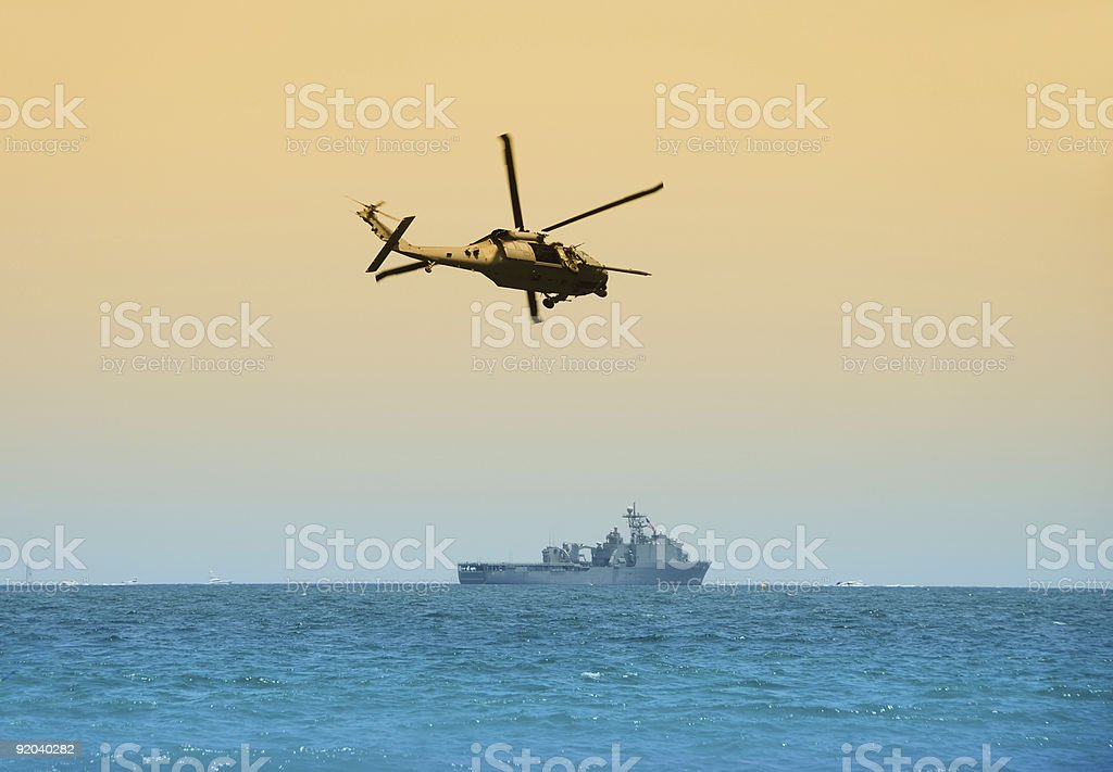 Helicopter hovering above the ocean stock photo