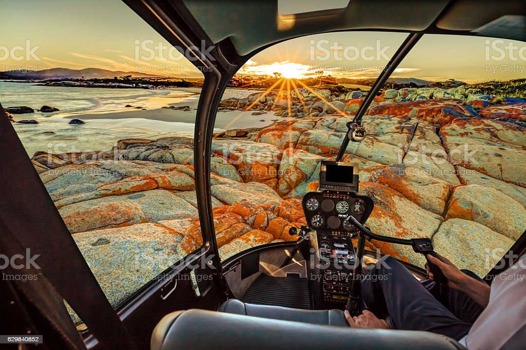 Helicopter in Bay of Fires stock photo