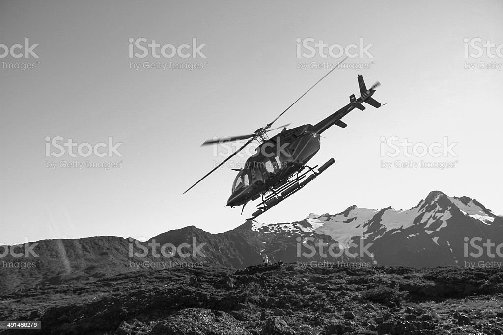 Helicopter in equilibrium on a mountain stock photo