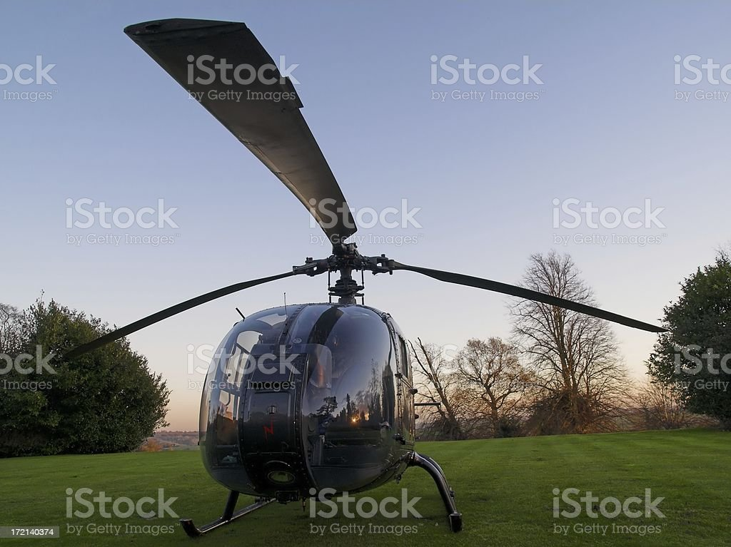 Helicopter in evening light royalty-free stock photo