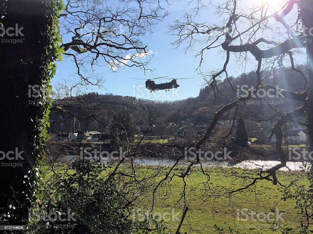 Helicopter in over the River Wye in Tintern stock photo