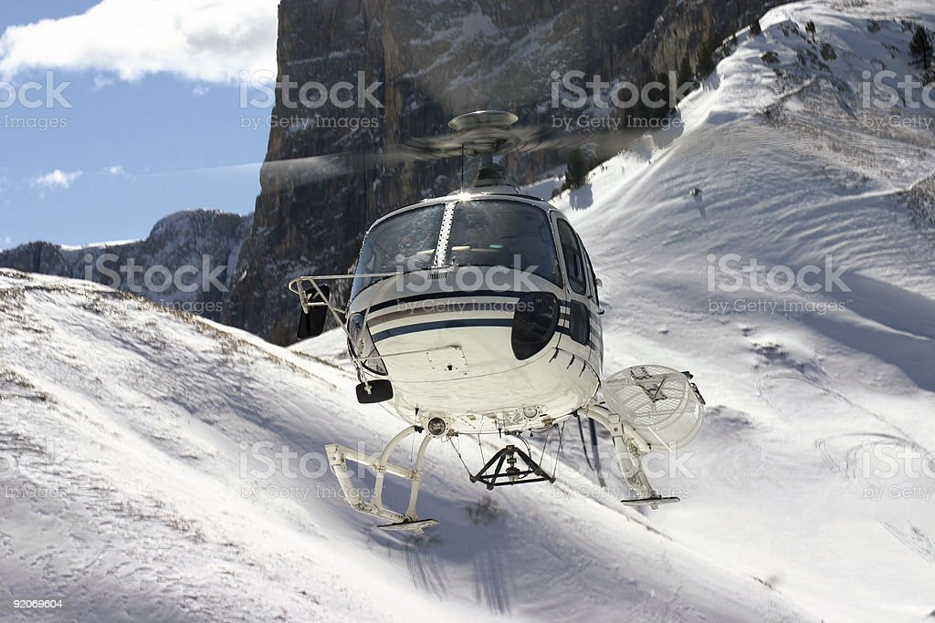 Helicopter in the dolomites stock photo