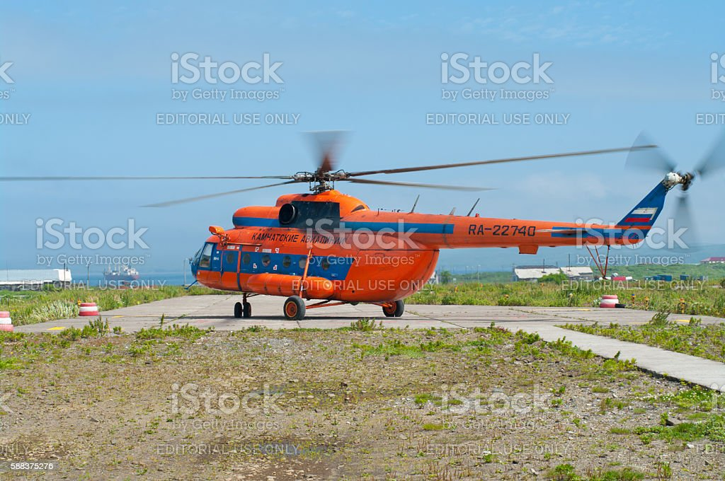 Helicopter is landing at the airport stock photo