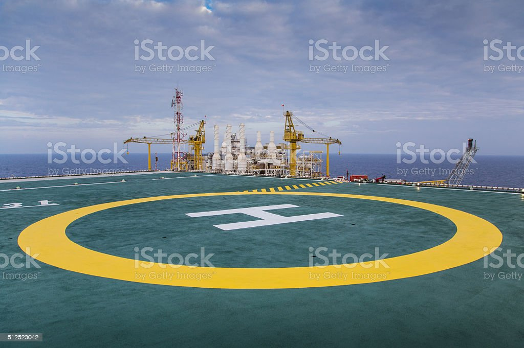 Helicopter landing area called heli pad background is gas platform stock photo
