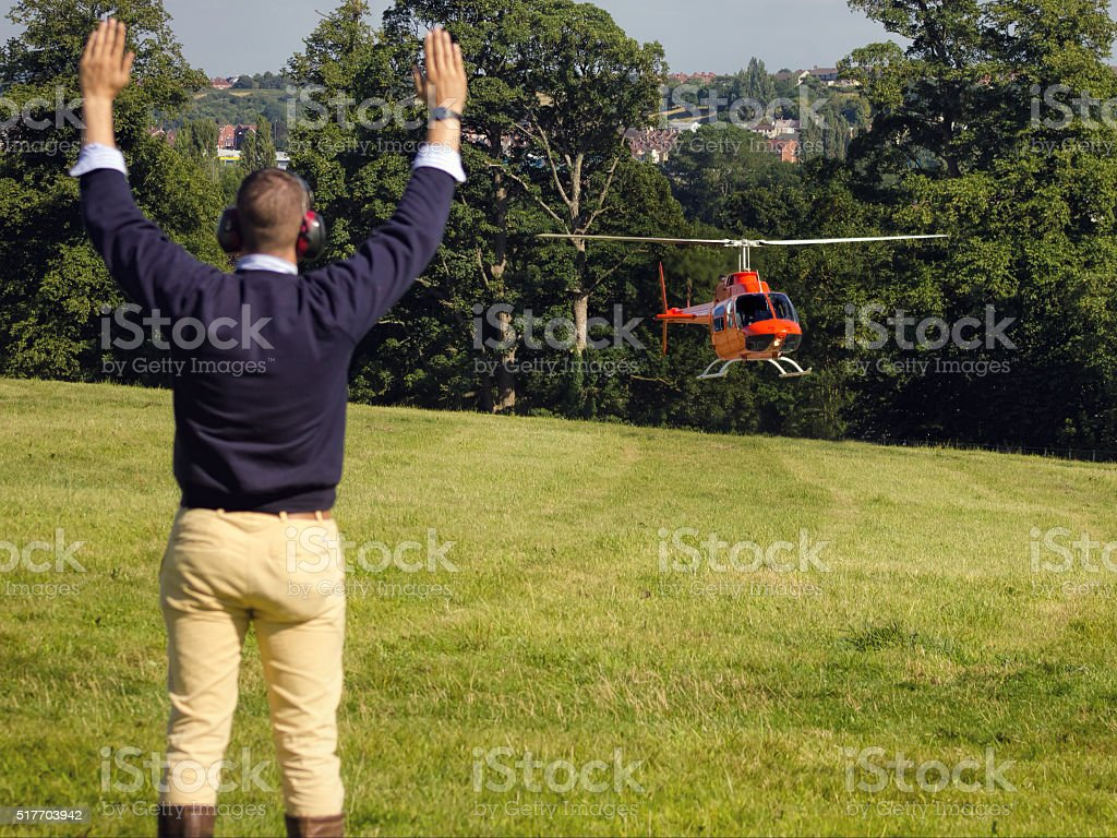 Helicopter Landing. Ground Crew Marshalling Visual Hand Signals. stock photo