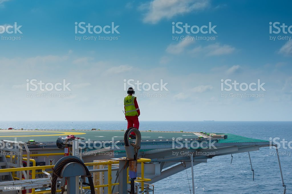 Helicopter landing officer on helicopter deck stock photo