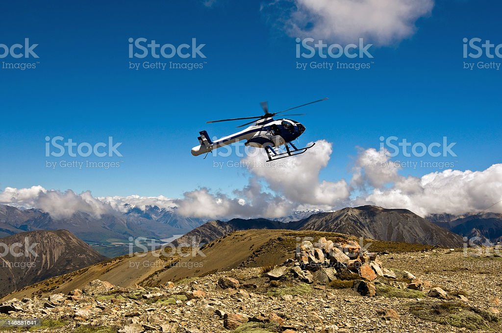 Helicopter Landing on a Mountain top. royalty-free stock photo