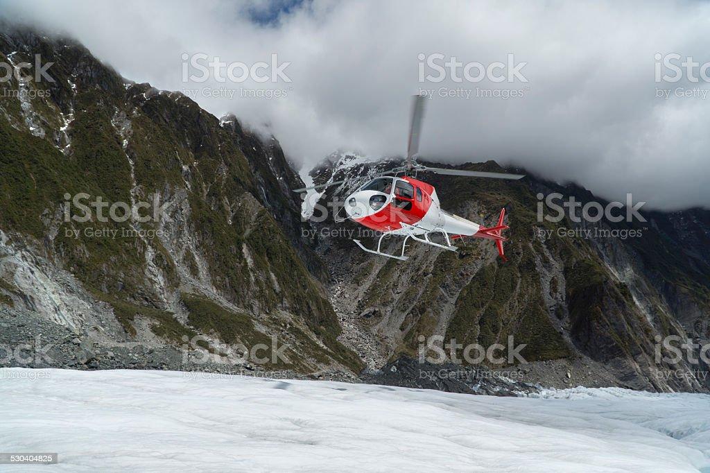 Helicopter landing on Franz Josef Glacier stock photo