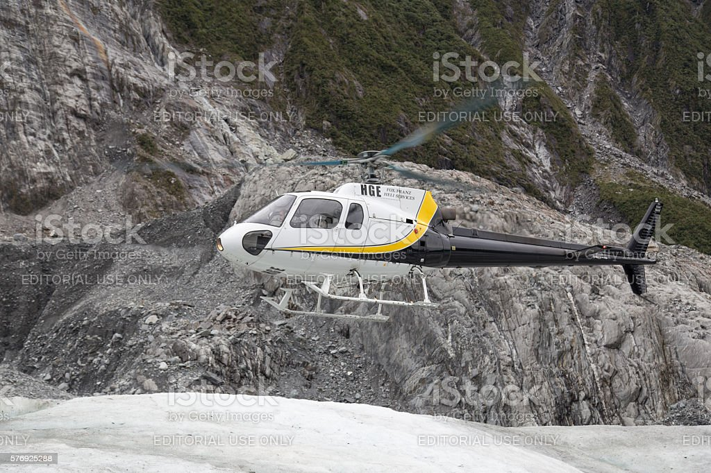 Helicopter landing on Franz Josef Glacier stock photo
