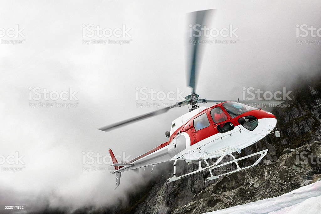 Helicopter landing on Franz Josef Glacier, Southern Alps, New Zealand stock photo
