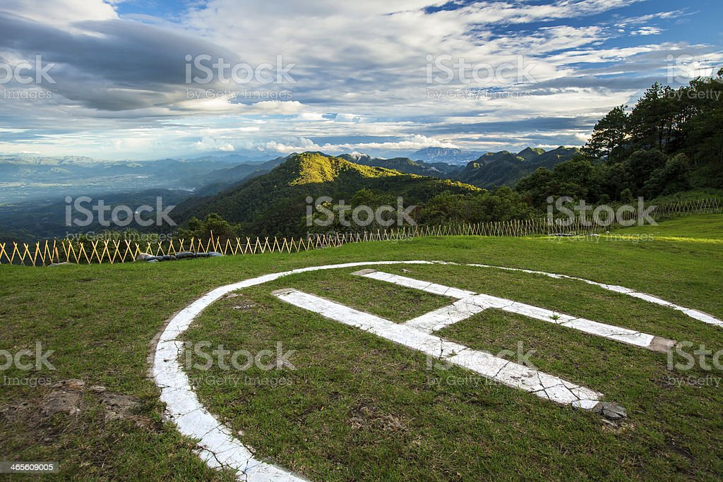 Helicopter landing on hill royalty-free stock photo