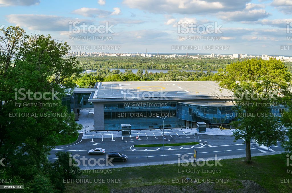 Helicopter landing on rooftop for president in downtown stock photo