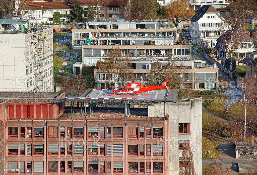 Helicopter landing on the hospital roof in Thun City stock photo