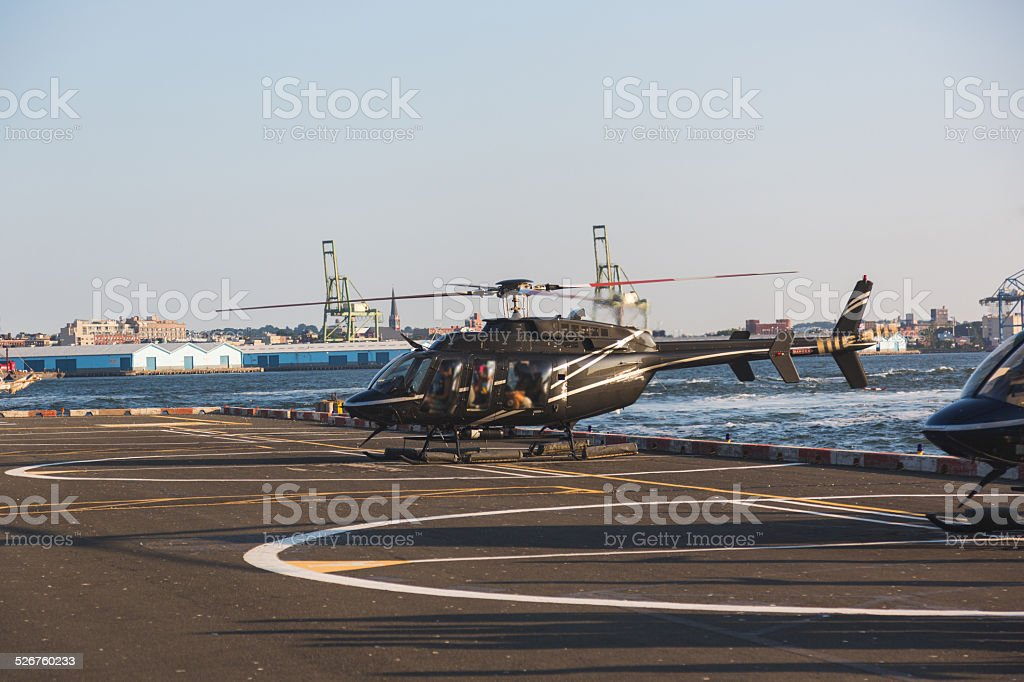 Helicopter Landing on the Pier stock photo