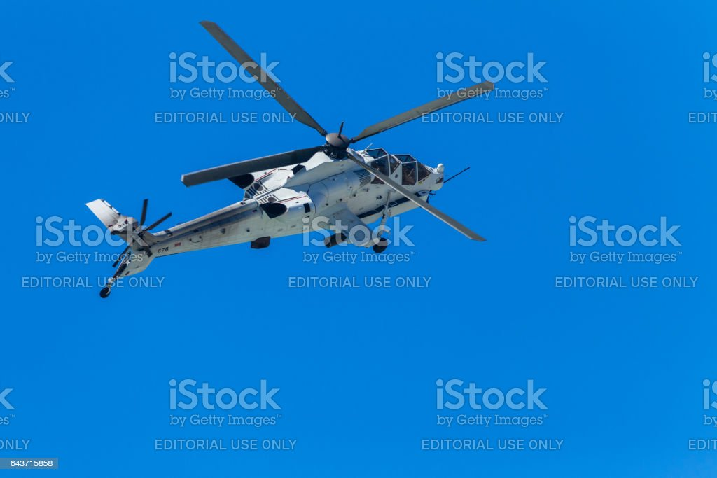 Helicopter Military Attack Flying Blue stock photo