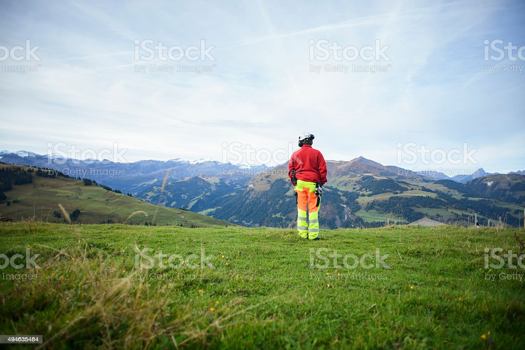 Helicopter Mountain Rescue Paramedic on Mountainside stock photo