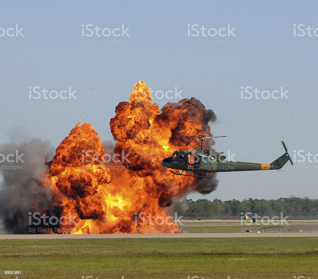 Helicopter near explosion stock photo