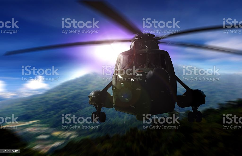 Helicopter on a rescue mission in a mountain stock photo