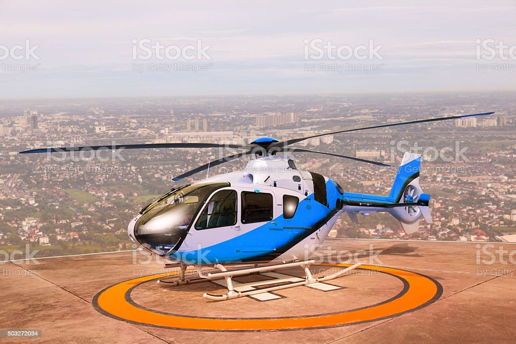 helicopter on building roof helipad stock photo