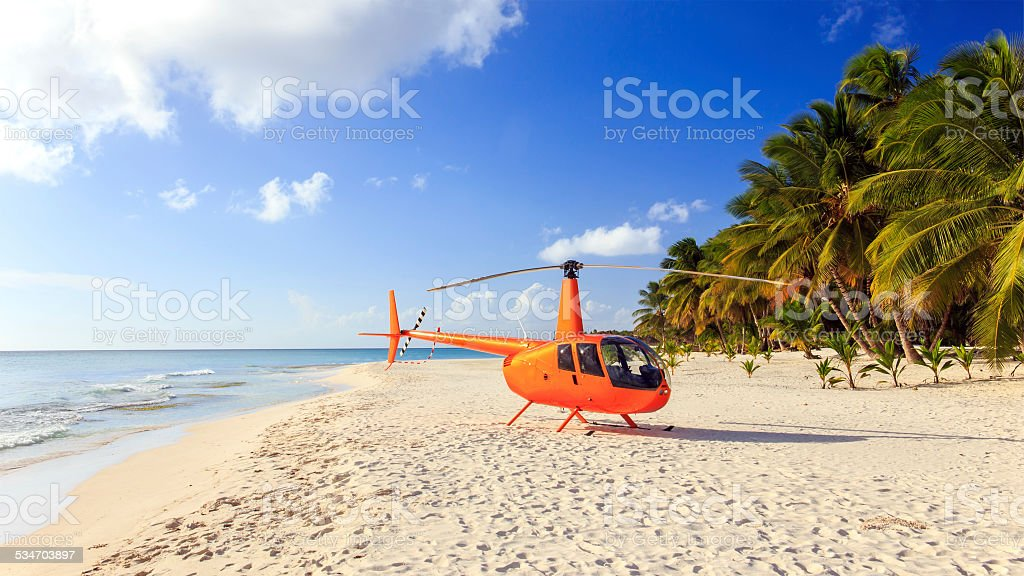 Helicopter on caribbean beach stock photo