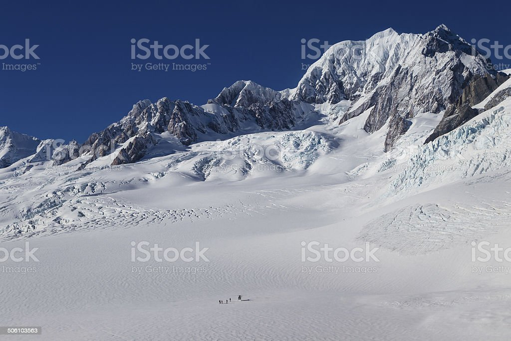 Helicopter on Fox Glacier with Mt. Tasman visible stock photo