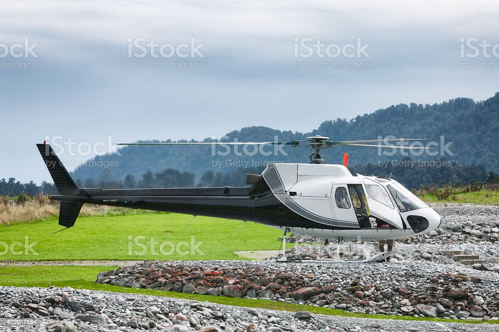 Helicopter on helipad in Franz Josef, New Zealand stock photo