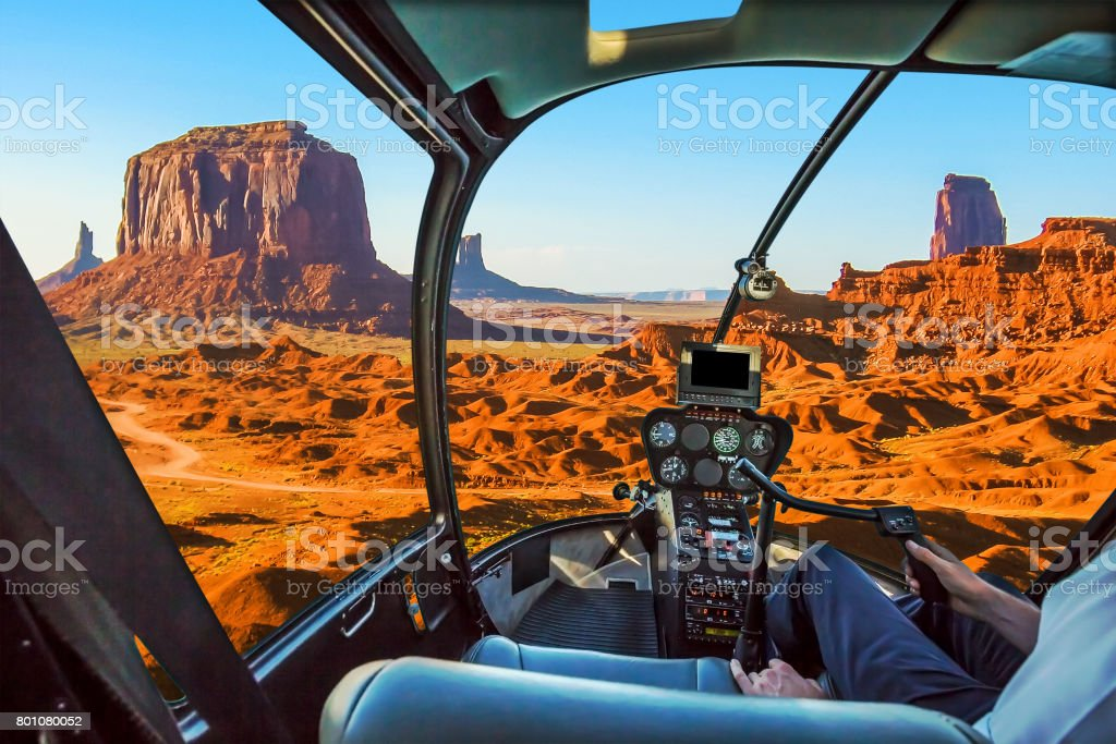 Helicopter on Monument Valley stock photo