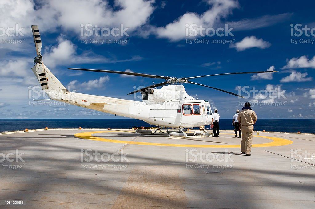 Helicopter on Offshore Oil Drilling Rig stock photo