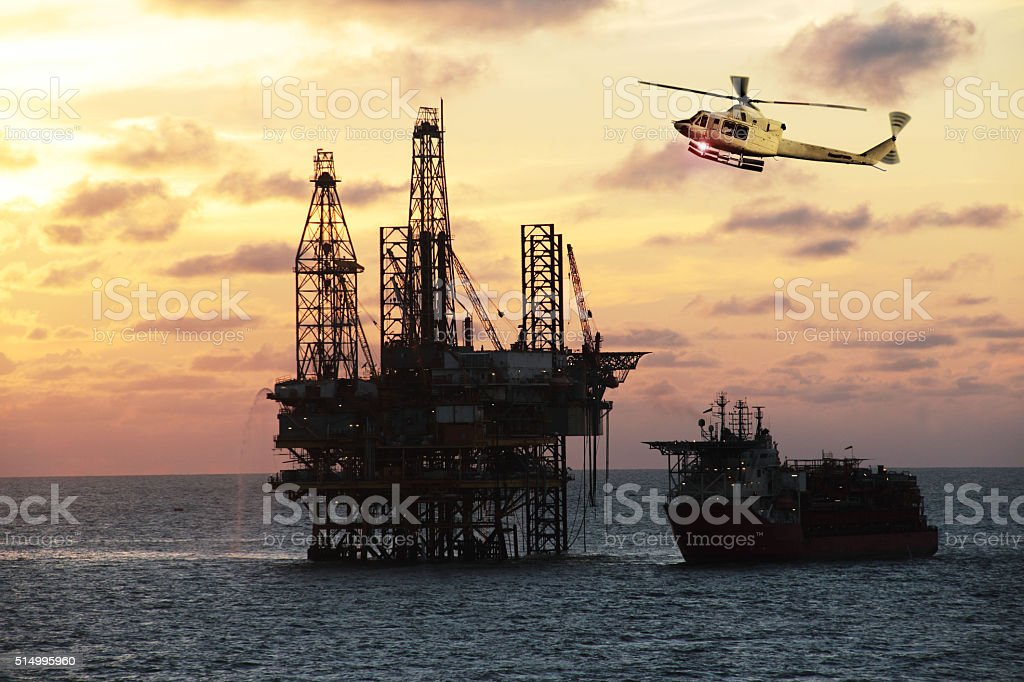 helicopter on sunset stock photo