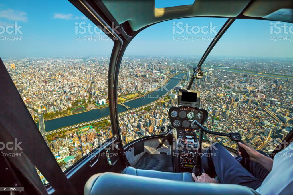 Helicopter on Tokyo skyline stock photo