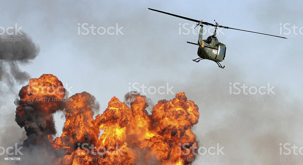 Helicopter over explosion stock photo