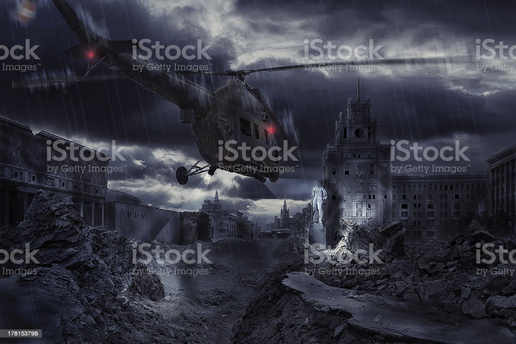 Helicopter over ruined city during storm royalty-free stock photo