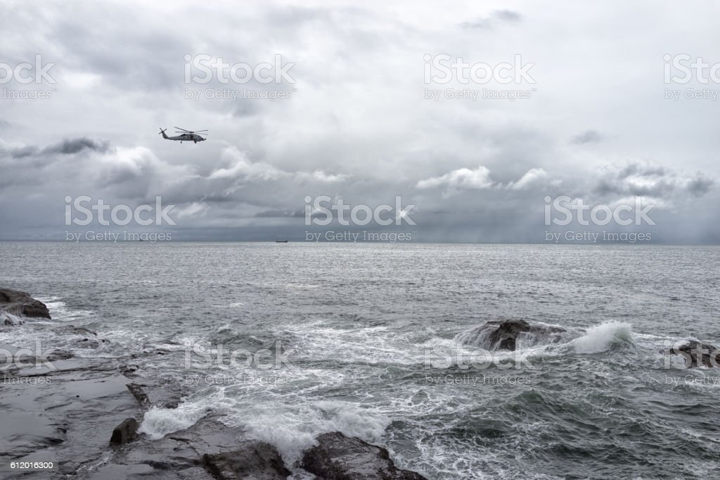 Helicopter over seaside stock photo