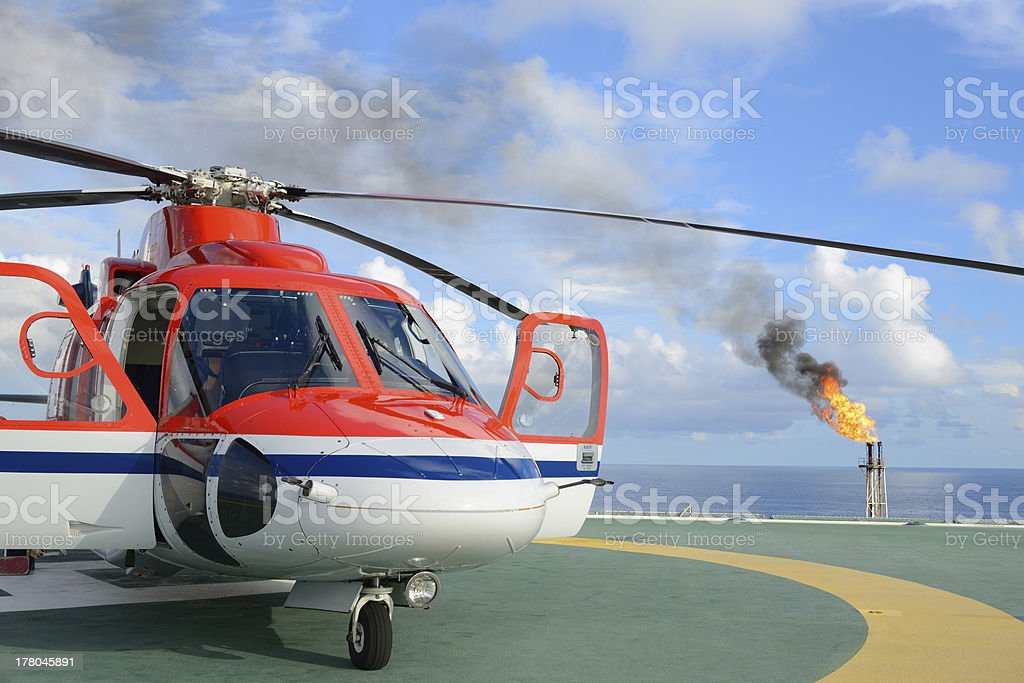 Helicopter park on oil rig stock photo